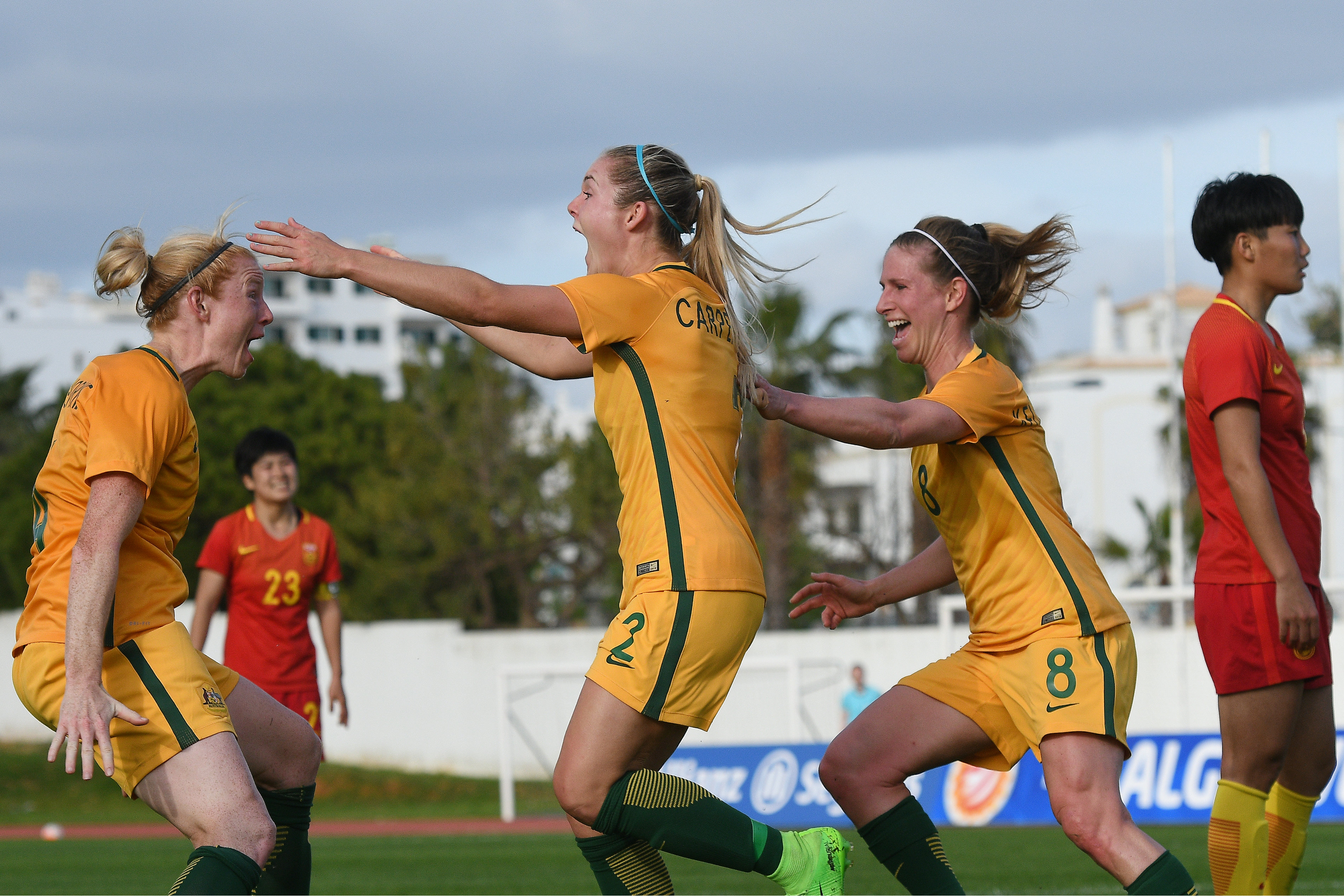 Ellie Carpenter celebrates scoring against China.