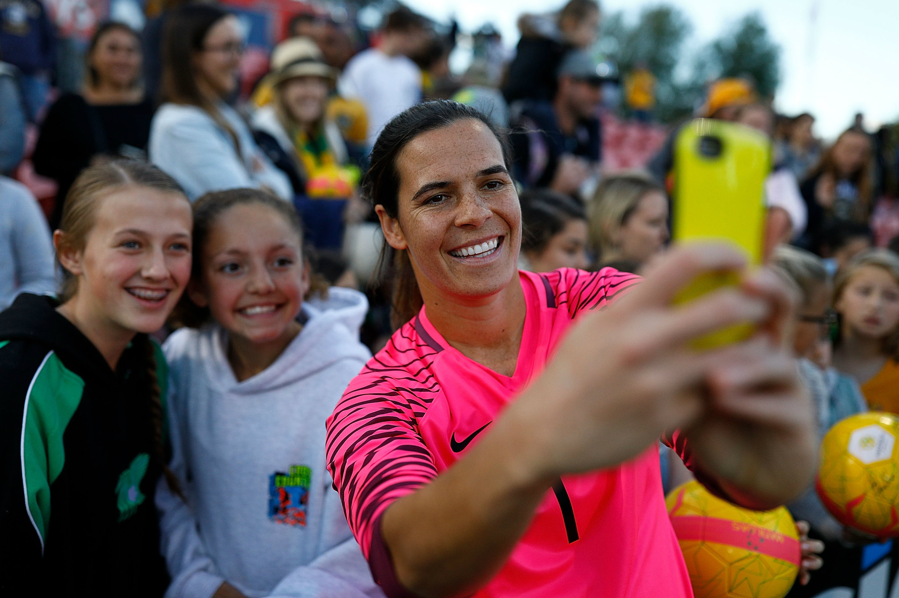 Westfield Matildas goalkeeper Lydia Williams takes a selfie with some fans.