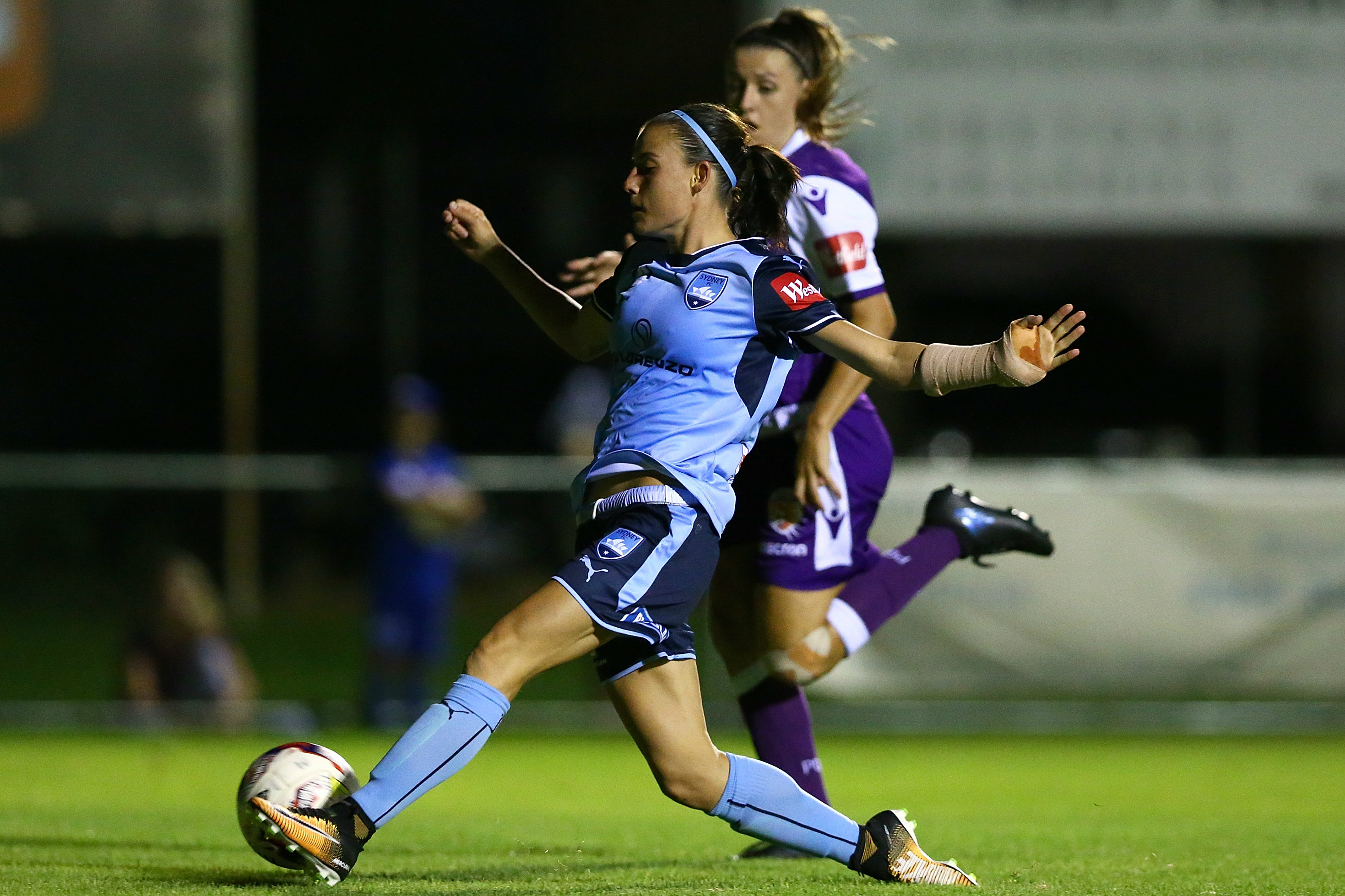 Chloe Logarzo sweeps home her goal in Sydney's win in the west.