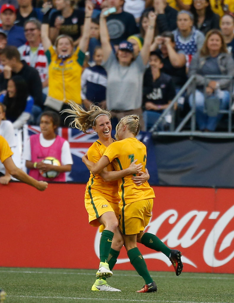 Tameka Butt and Elise Kellond-Knight celebrate the goal against the United States