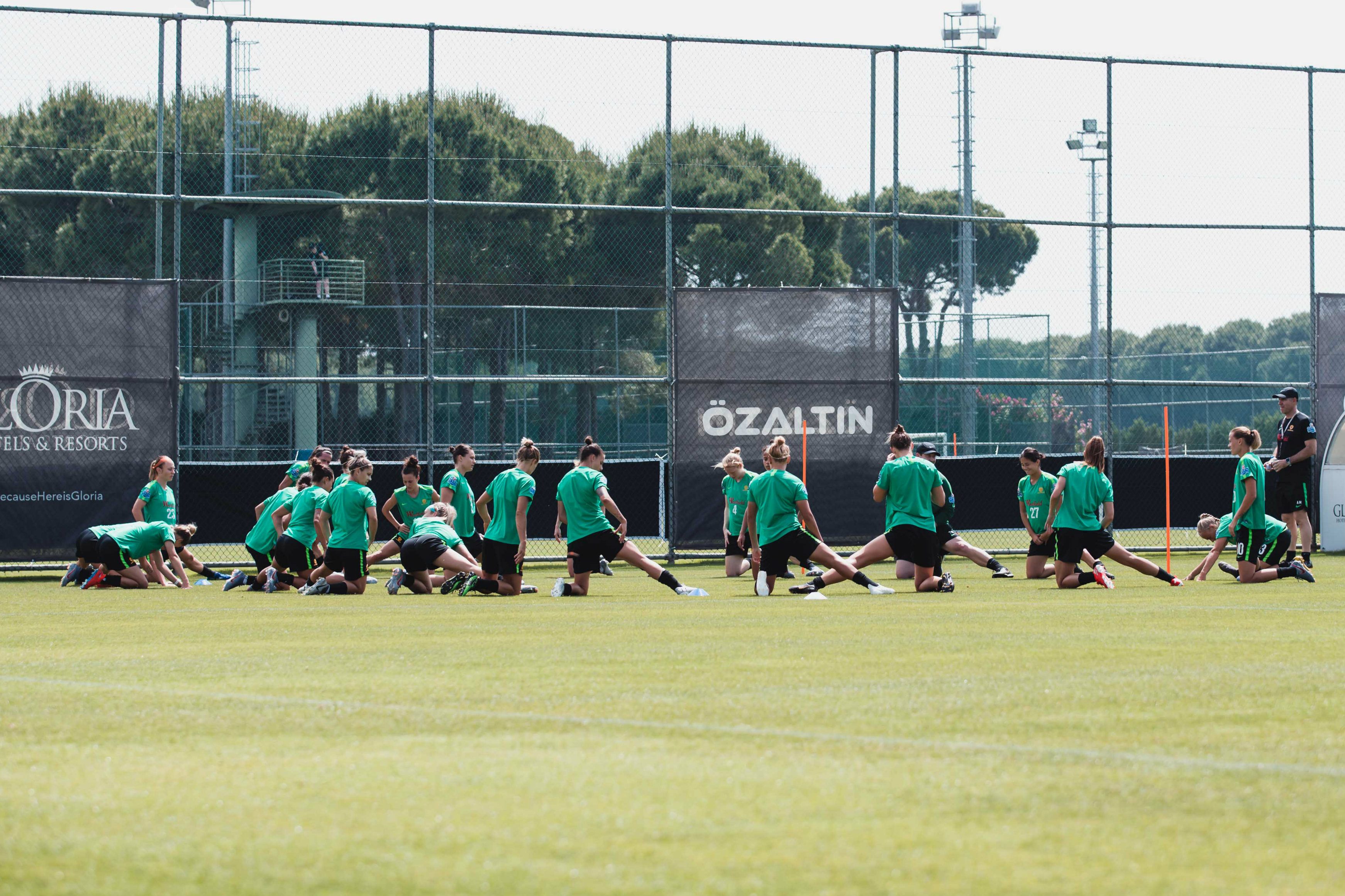 Westfield Matildas players stretch down after an intense session