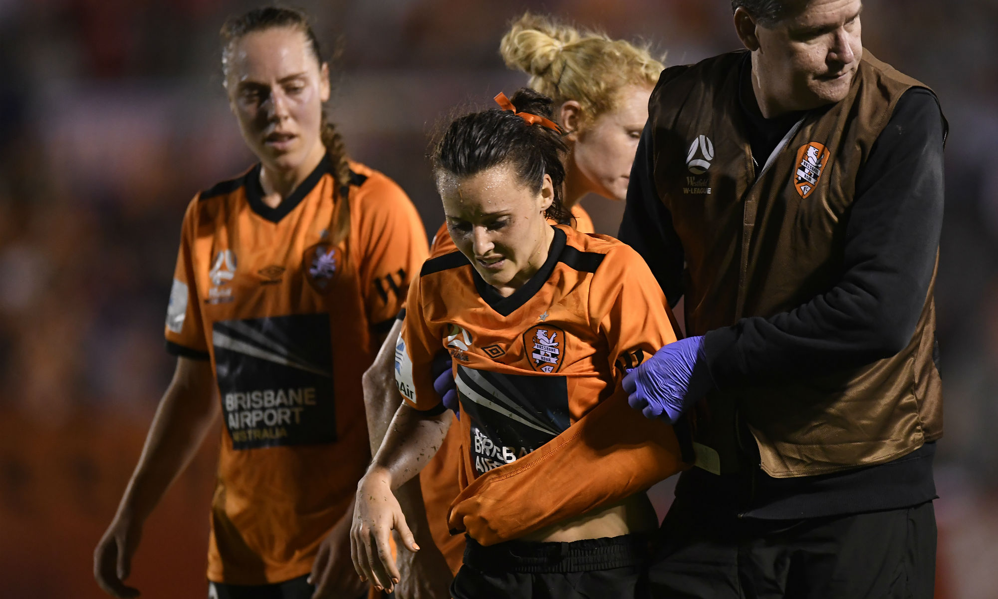 Hayley Raso is helped from the field in the final stages of Brisbane Roar's 3-1 loss against Melbourne Victory in Round 2.