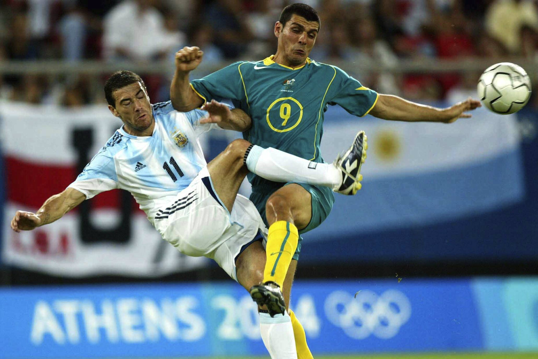 John Aloisi in action against Argentina at the 2004 Olympics