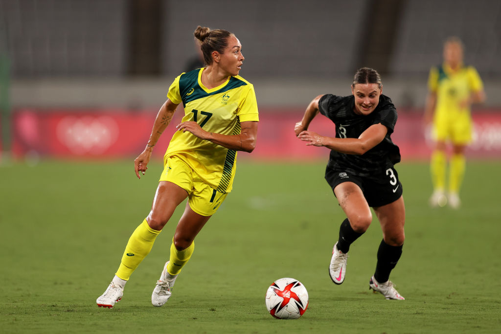Kyah Simon #17 of Team Australia battles for possession with Anna Green #3 of Team New Zealand during the Women's First Round Group G match between Australia and New Zealand during the Tokyo 2020 Olympic Games at Tokyo Stadium on July 21, 2021 in Chofu, Tokyo, Japan. (Photo by Dan Mullan/Getty Images)