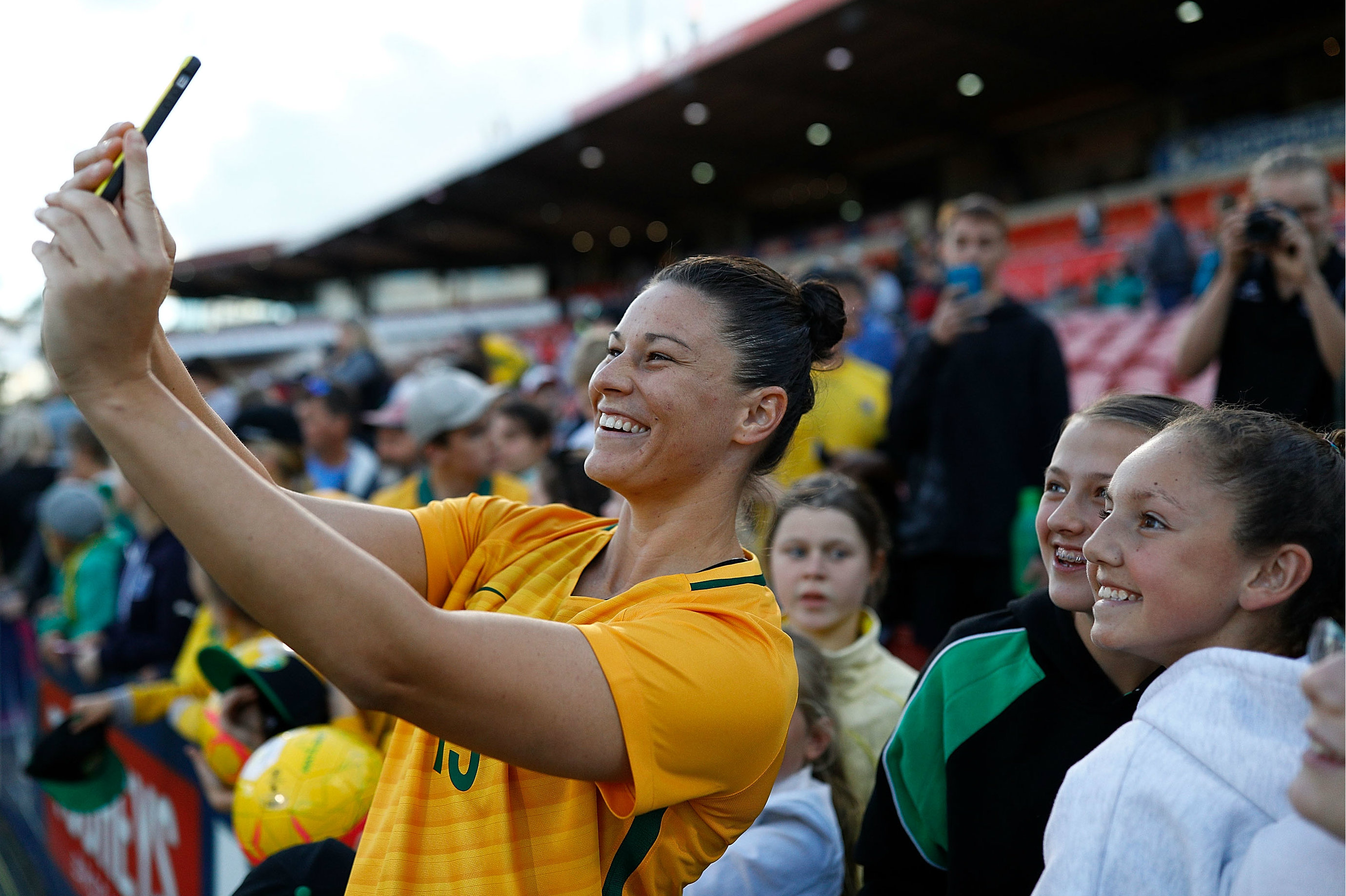Emily Gielnik takes a selfie with some Westfield Matildas fans.