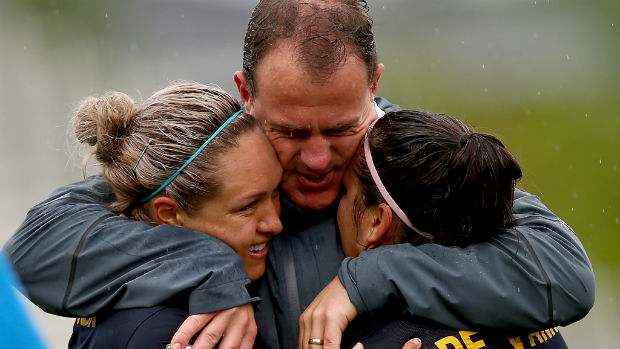 Westfield Matildas coach Alen Stajcic embraces Kyah Simon and Lisa De Vanna after Australia beat Brazil at the Women's World Cup.