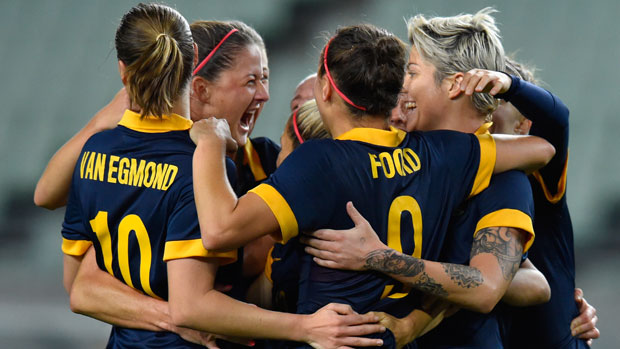 Matildas players celebrate a goal during the Olympic qualifiers in Japan.