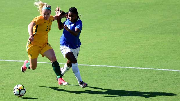 Ellie Carpenter holds off a Brazilian attacker during Australia's 6-1 win at the Tournament of Nations.