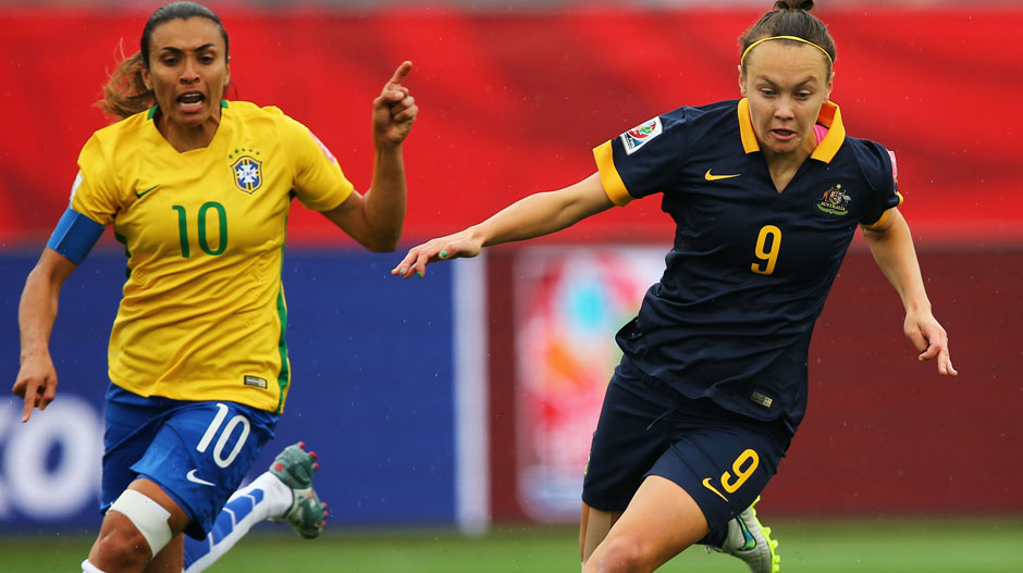 Matildas fullback Caitlin Foord wins the ball in front of Brazilian superstar Marta.