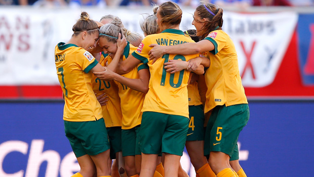 Matildas players celebrate a goal against Nigeria at the 2015 FIFA World Cup.
