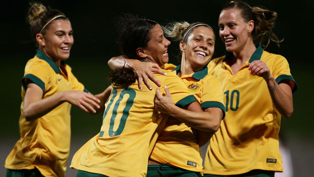 Matildas players celebrate a goal in their demolition of Vietnam.