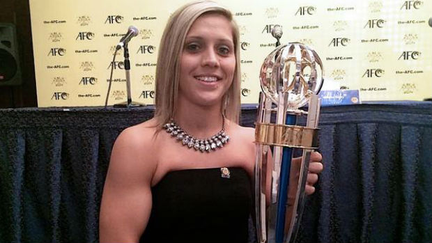 Katrina Lee Gorry with her AFC Women's Player of the Year trophy.