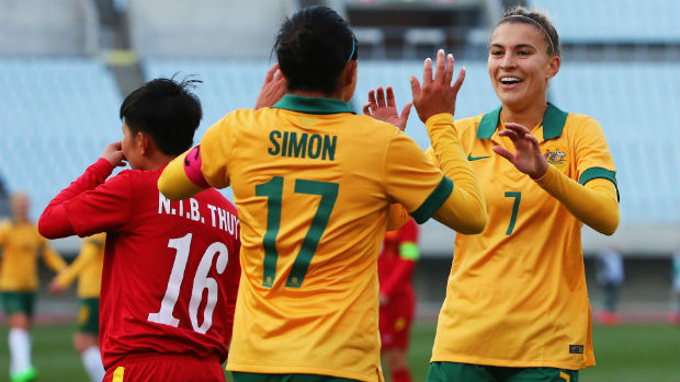 Westfield Matildas Kyah Simon and Steph Catley celebrate a goal against Vietnam.