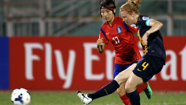 Westfield Matildas co-captain Clare Polkinghorne passes the ball against Korea Republic at the 2014 AFC Women's Asian Cup.