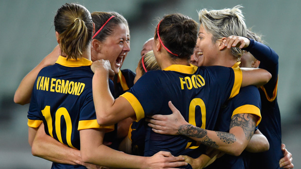 Matildas players celebrate Michelle Heyman's first-half strike against DPR Korea.