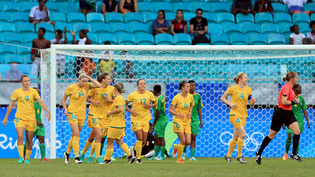 The Australian Women's Football Team celebrate one of their six goals against Zimbabwe at the Games.