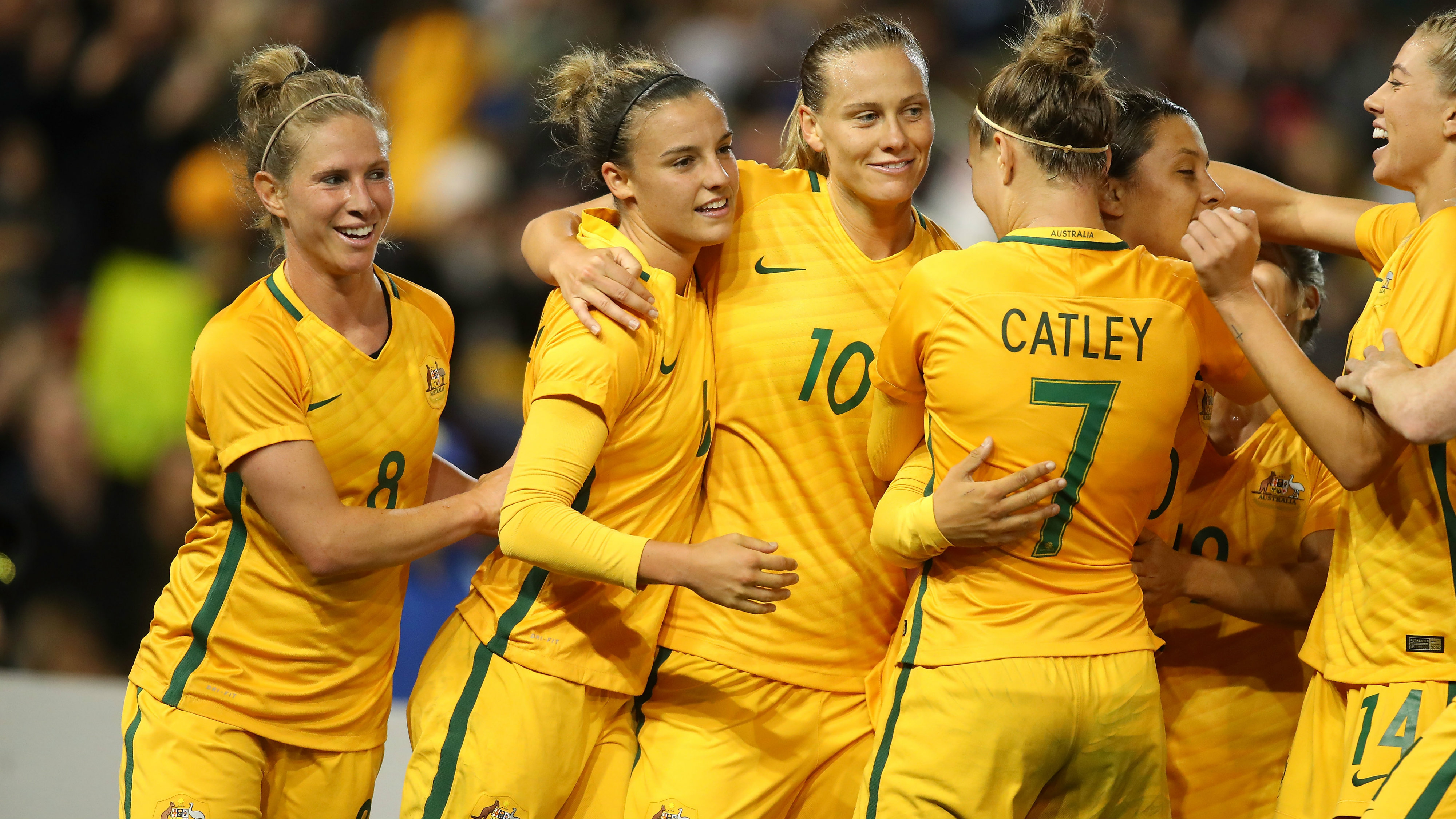 Westfield Matildas players celebrate a goal in their 3-2 win over Brazil in Newcastle.