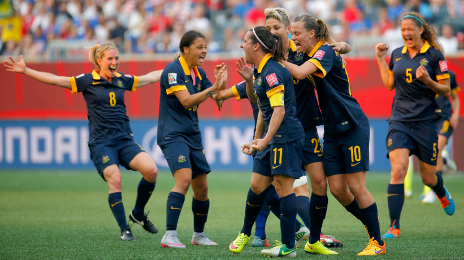 The Matildas celebrate after deservedly drawing level, the sides going into the break locked at 1-1.