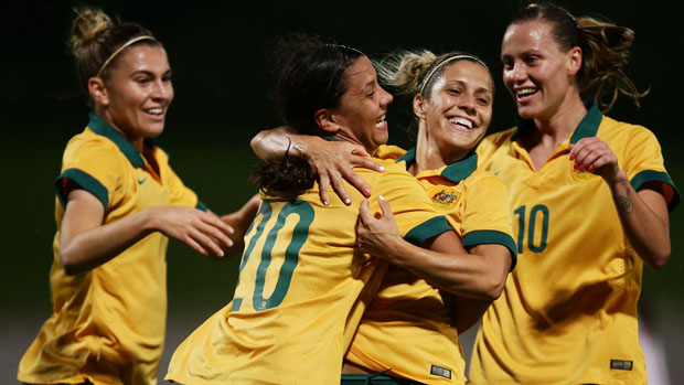 Sam Kerr celebrates with her Matildas teammates.
