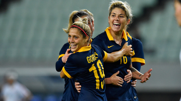 Michelle Heyman and Katrina Gorry celebrate a goal during the Matildas' Olympic qualifiers.