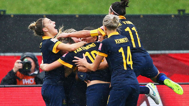 Steph Catley celebrates a goal with her Matildas teammates.