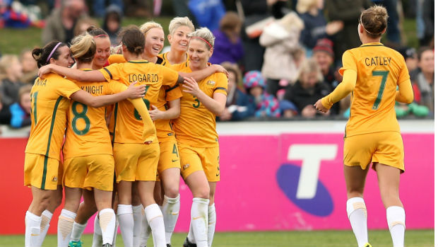 Steph Catley joins her Westfield Matildas teammates to celebrate a goal against New Zealand in a friendly.