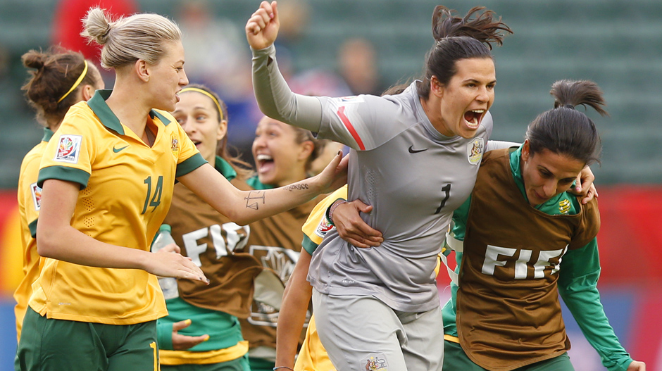 Lydia Williams celebrates with teammates after the Matildas qualify for the round of 16.