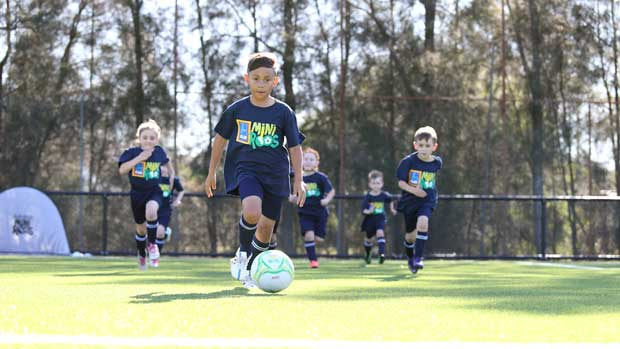 Youngsters enjoying the ALDI MiniRoos football activities.