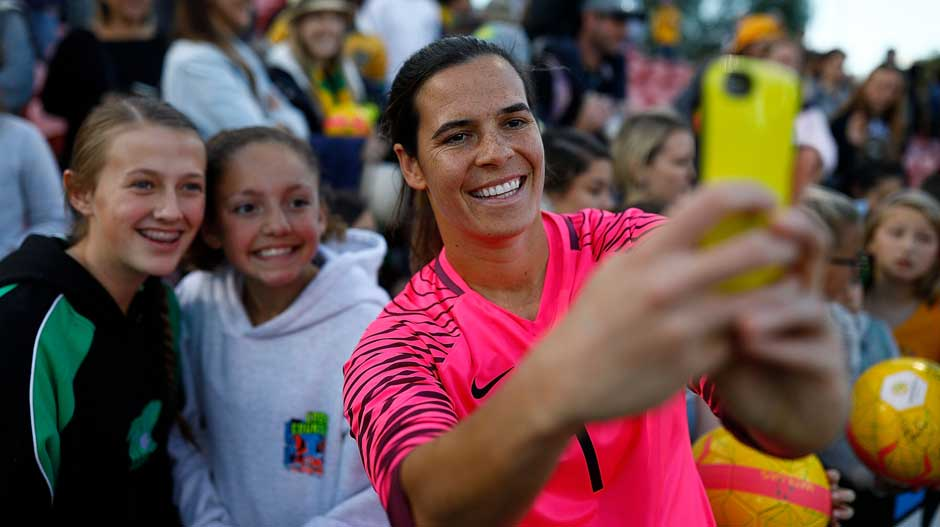 Goalkeeper Lydia Williams takes a selfie with a lucky fan.