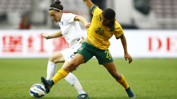 Sam Kerr tries to win the ball from England's Lucy Bronze.