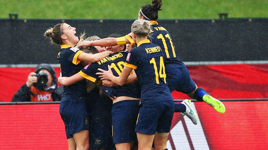 Matildas players celebrate Kyah Simon's goal against Brazil.