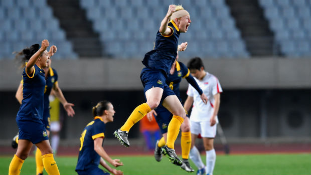 Co-captain Clare Polkinghorne leads the celebrations following the Matildas' win over DPR Korea.
