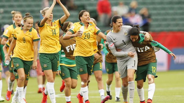 Matildas players celebrate at the 2015 World Cup in Canada.