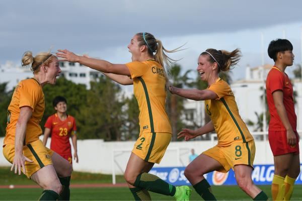 Ellie Carpenter celebrates scoring against China.