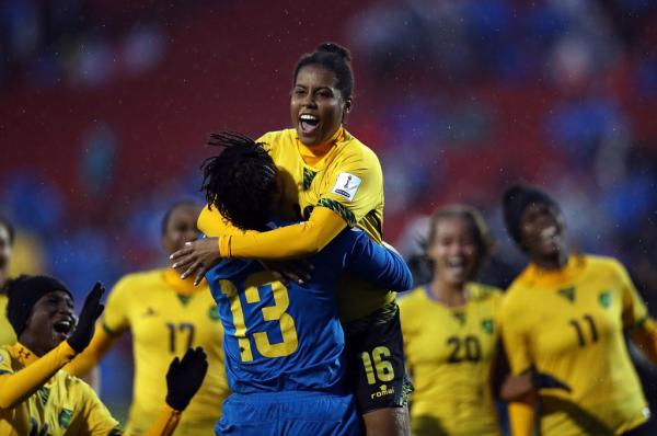 Dominique Bond-Flasza, of Jamaica, celebrates scoring the winning penalty in the shootout against Panama in the 2018 CONCACAF Women's Championship