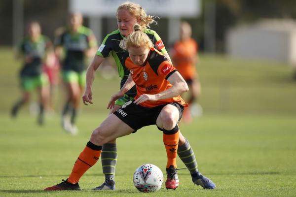 Clare Polkinghorne shields the ball in the Westfield W-League