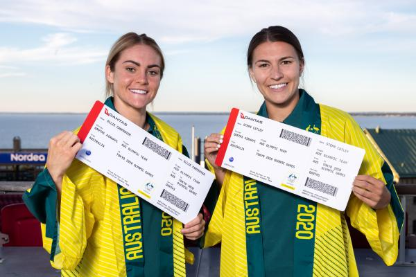 Ellie Carpenter and Steph Catley with their Tokyo 2020 Olympic Qantas boarding passes
