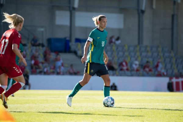 Emily van Egmond on the ball in her 100th game
