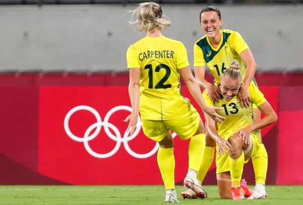 Tameka Yallop (Bottom R) celebrates with Australia's forward Hayley Raso (Rear R) and Australia's defender Ellie Carpenter after opening the scoring during the Tokyo 2020 Olympic Games women's group G first round football match between Australia and New Zealand at the Tokyo Stadium in Tokyo on July 21, 2021. (Photo by Yoshikazu TSUNO / AFP) (Photo by YOSHIKAZU TSUNO/AFP via Getty Images)