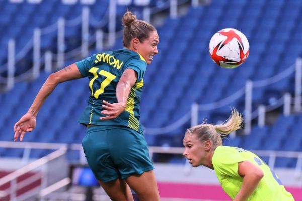 Australia's forward Kyah Simon (L) heads the ball during the Tokyo 2020 Olympic Games women's group G first round football match between Sweden and Australia at the Saitama Stadium in Saitama on July 24, 2021. (Photo by Ayaka Naito / AFP) (Photo by AYAKA NAITO/AFP via Getty Images)