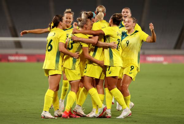 ameka Yallop #13 of Team Australia celebrates with team mates after scoring their side's first goal during the Women's First Round Group G match between Australia and New Zealand during the Tokyo 2020 Olympic Games at Tokyo Stadium on July 21, 2021 in Chofu, Tokyo, Japan. (Photo by Dan Mullan/Getty Images)