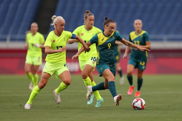 SAITAMA, JAPAN - JULY 24: Caitlin Foord #9 of Team Australia battles for possession with Caroline Seger #17 of Team Sweden during the Women's First Round Group G match between Sweden and Australia on day one of the Tokyo 2020 Olympic Games at Saitama Stadium on July 24, 2021 in Saitama, Japan. (Photo by Francois Nel/Getty Images)