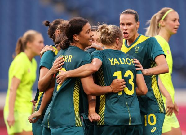 Sam Kerr #2 of Team Australia celebrates with team mates after scoring their side's second goal during the Women's First Round Group G match between Sweden and Australia on day one of the Tokyo 2020 Olympic Games at Saitama Stadium on July 24, 2021 in Saitama, Japan. (Photo by Francois Nel/Getty Images)