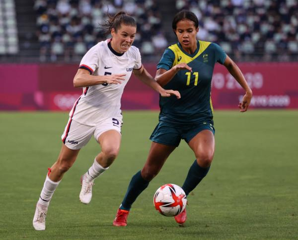 Kelley O'Hara #5 of Team United States looks to break past Mary Fowler #11 of Team Australia during the Women's Football Group G match between United States and Australia on day four of the Tokyo 2020 Olympic Games at Kashima Stadium on July 27, 2021 in Kashima, Ibaraki, Japan. (Photo by Atsushi Tomura/Getty Images)