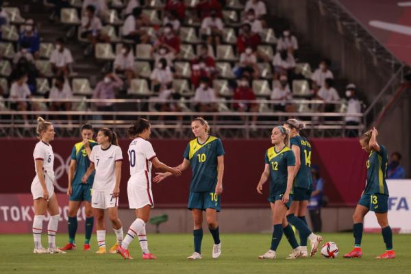 Australian and American players shake hands after their draw at the Olympics