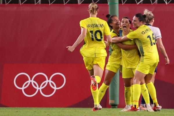 Sam Kerr #2 of Team Australia celebrates with team mates after scoring their side's fourth goal during the Women's Quarter Final match between Great Britain and Australia on day seven of the Tokyo 2020 Olympic Games at Kashima Stadium on July 30, 2021 in Kashima, Ibaraki, Japan. (Photo by Atsushi Tomura/Getty Images)