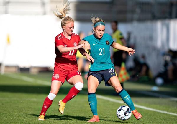 Ellie Carpenter battles for the ball v Denmark