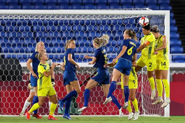Sam Kerr #2 of Team Australia competes for the ball with during the match between Team Australia and Sweden on day ten of the Tokyo 2020 Olympic Games at International Stadium Yokohama on August 02, 2021 in Yokohama, Kanagawa, Japan. (Photo by Zhizhao Wu/Getty Images)