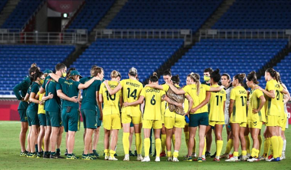 Australia's players gather in a huddle after their loss during the Tokyo 2020 Olympic Games women's semi-final football match between Australia and Sweden at Yokohama International Stadium in Yokohama on August 2, 2021. (Photo by Anne-Christine POUJOULAT / AFP) (Photo by ANNE-CHRISTINE POUJOULAT/AFP via Getty Images)