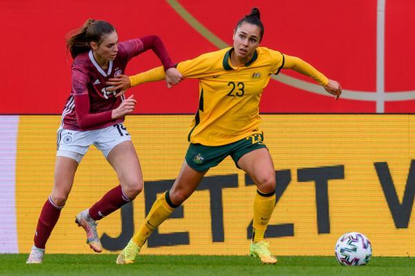 Emma Checker shields the ball v Germany